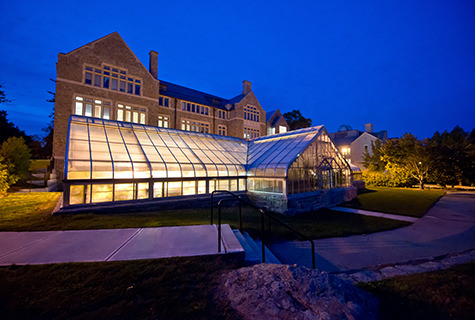 The greenhouse outside New London Hall at night.