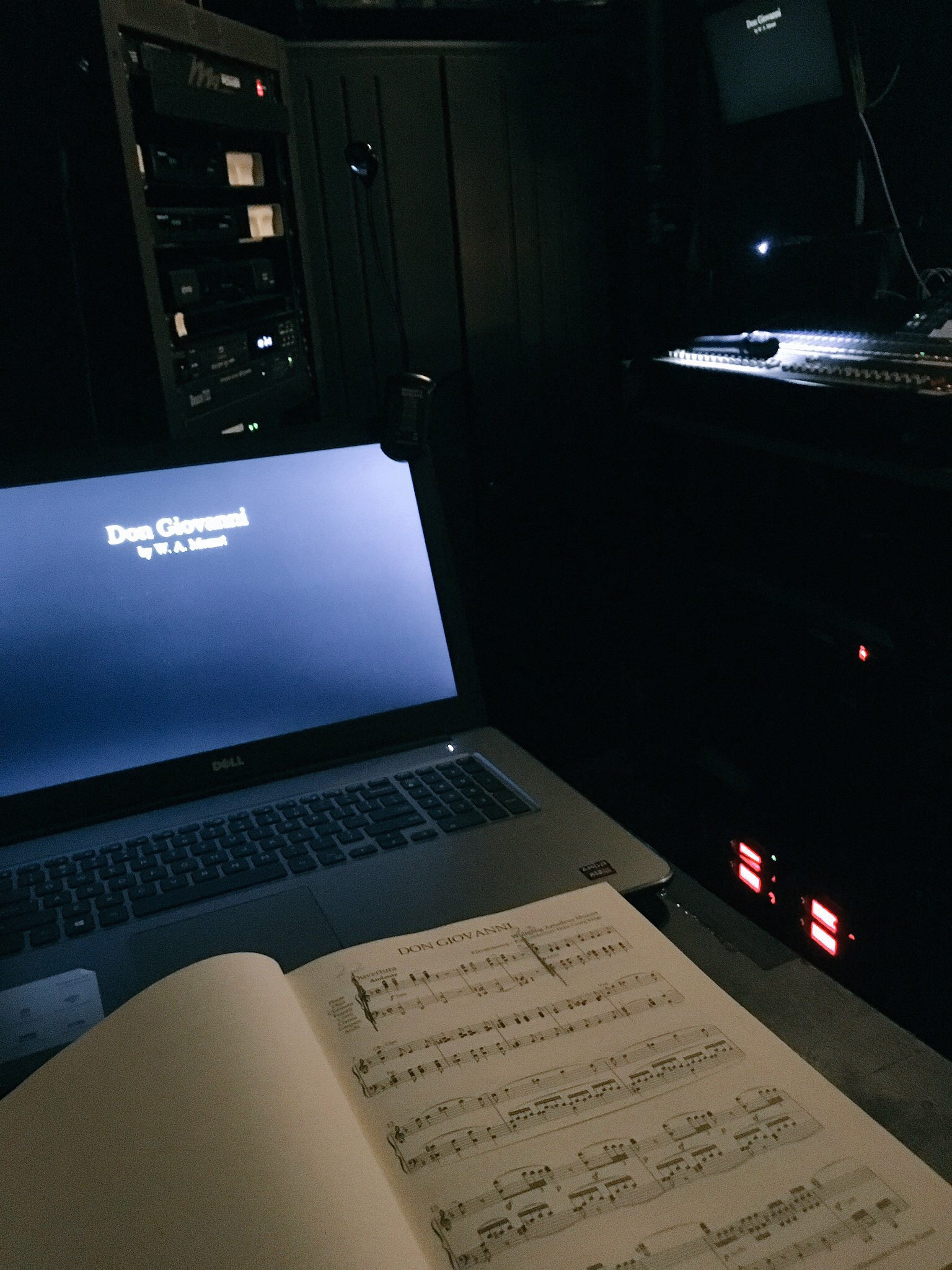 Saadya lays out the music for Don Giovanni in front of his open macbook laptop, ready to transcribe the lyrics