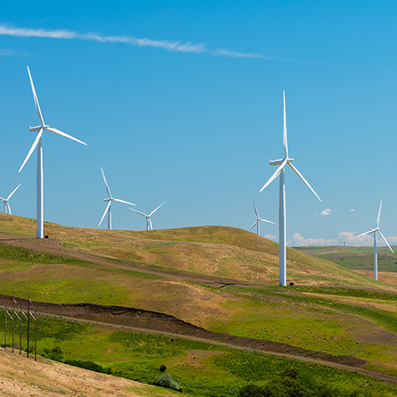 Wind turbines on a hilly landscape.